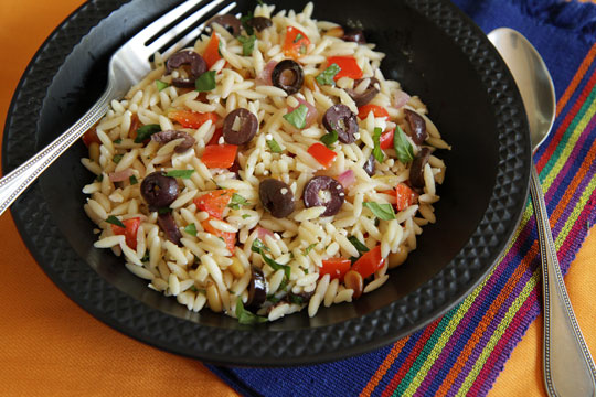Orzo salad with olives, veggies and pine nuts