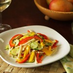 Salad with mango, pickled cucumbers and bell peppers