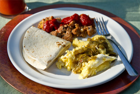 Christmas Breakfast: Scrambled eggs with green chile, Chorizo with red chile. @MJsKitchen