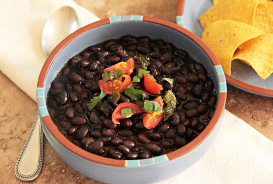 Bowl of black beans with tortilla chips