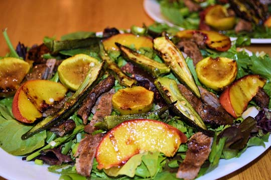 Grilled vegetable salad with meat, okra and peaches
