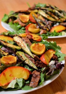 Grilled salad with figs, okra, peaches and a meat