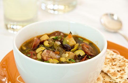 A spicy soup with andouille and blank beans mjskitchen.com
