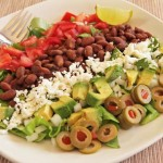 Salad plate with beans, tomatoes, feta, and avocado