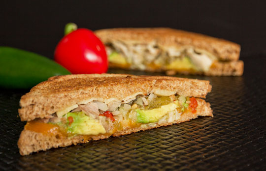 A southwestern grilled cheese with green chile, turkey, avocado