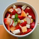 Salad with tomatoes, strawberries, preserved lemons and cheese