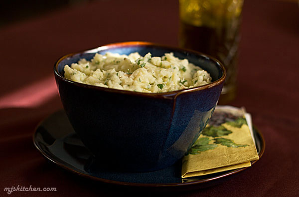 Mashed potatoes with roasted garlic and fresh herbs