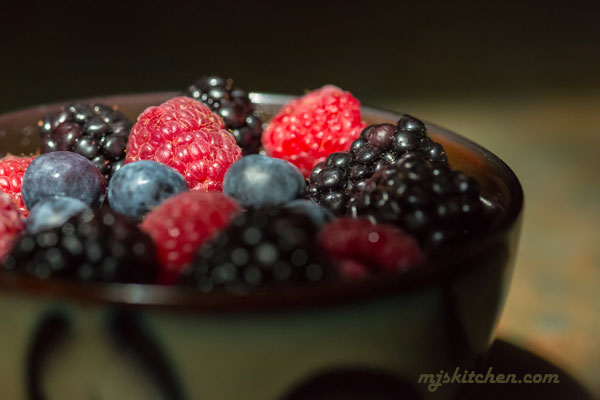 Bowl of raspberries, blueberries and blackberries