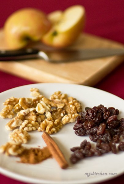 Ingredients for an apple, walnuts, and raisin snack