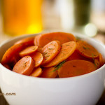Carrots cooked in bourbon, sweetened with honey and topped with dill