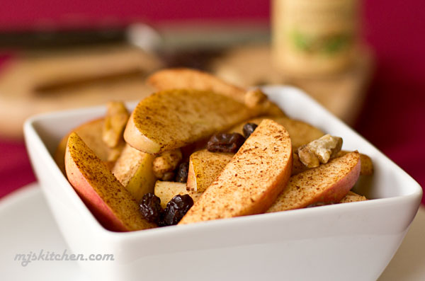 An easy snack made with apples, walnuts, raisins and cinnamon