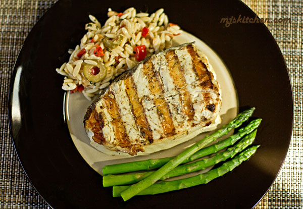 Grilled Halibut-spread with mayo before grilling for a moist fish. mjskitchen.com