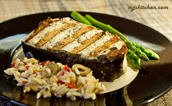 Smother halibut with mayonnaise and grill