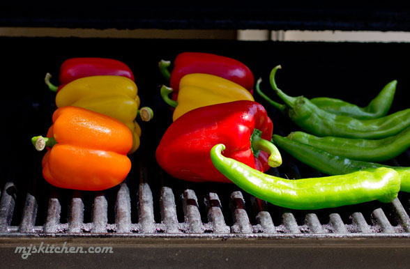 Roasting Bell Peppers and green chile on the grill
