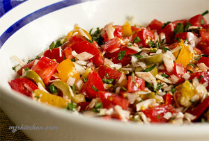 A pasta sauce with fresh tomatoes, basil, olives and cheese