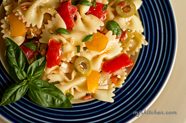 Farfalle with fresh tomatoes, basil olives and cheese