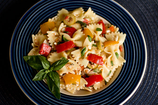 Pasta, fresh tomatoes, basil, olives and cheese