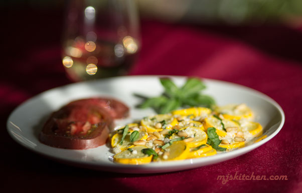 A quick sauteed yellow squash with fresh basil and toasted pinon (pine nuts)