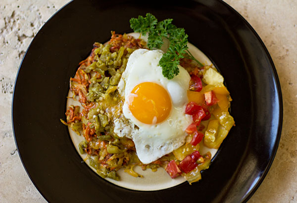 Sweet potato hash browns with green chile, cheese, and an egg