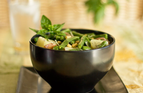 A hearty bowl of green beans and potatoes with pesto
