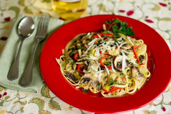 A vegetarian pasta with leek confit, mushrooms, and sweet red peppers