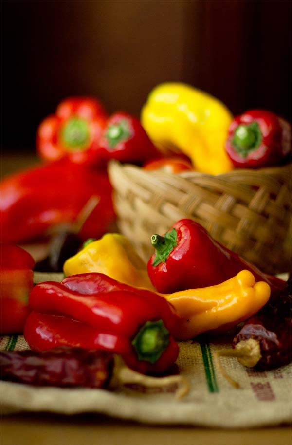 An assortment and sweet peppers and red chile peppers