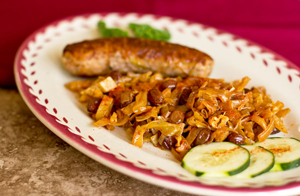 Sausage braised with cabbage, onions and raisins