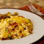 Southwestern style migas is a dish that consists of scrambled eggs, green chile, and fried corn tortillas