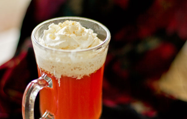 Rooibos chai brewed in cranberry juice, topping with whipped cream and ginger mjskitchen.com