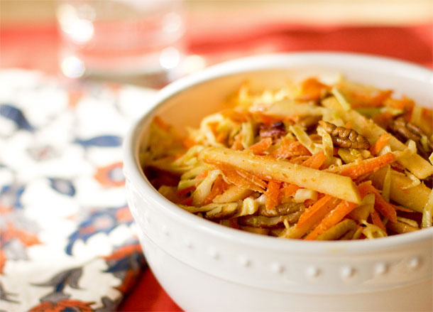 Apple Slaw with apples, cabbage, carrots, toasted pecans seasoned with masala spice. mjskitchen.com