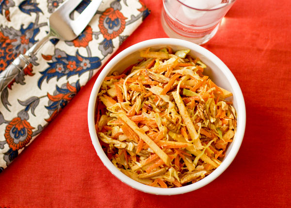 Slaw with apples, cabbage, carrots, toasted pecans seasoned with masala spice. mjskitchen.com