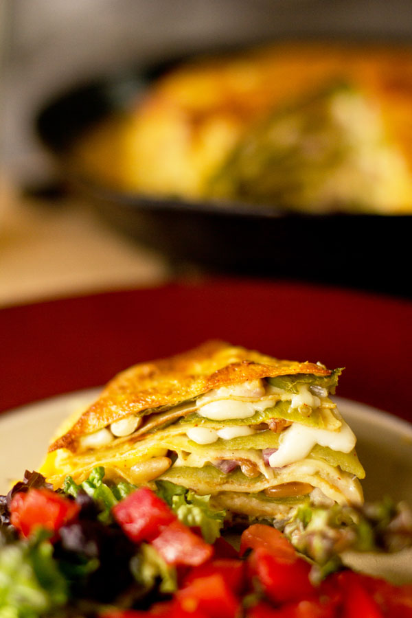 Green chile stacked with crepes (Pathiri), pine nuts (pinon) and queso fresco. mjskitchen.com @MJsKitchen