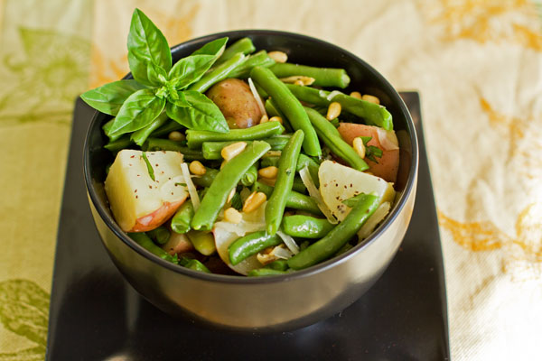 A hearty bowl of green beans and potatoes with deconstructed pesto