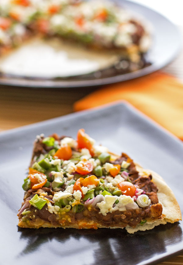 A simple pizza made on a flour tortilla and topped with beans and a spicy mole' sauce | mjskitchen.com