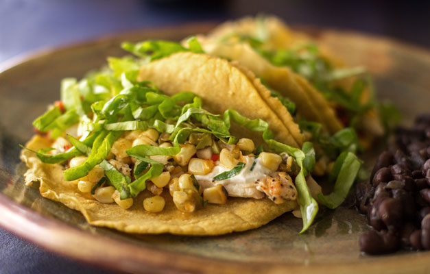 Tasty chicken tacos with green chile corn relish, olives, cheese and yogurt | mjskitchen.com