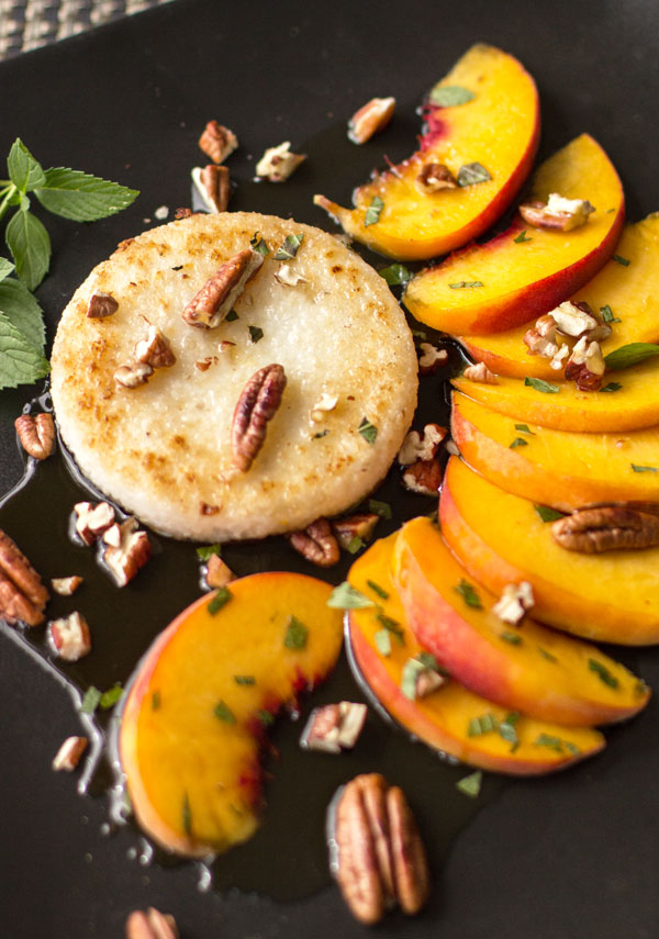 What's not to like about peaches and grits? Enjoy this breakfast of fried grits, fresh peaches, toasted pecans and mint, topped with maple syrup. #breakfast #grits #peaches @mjskitchen