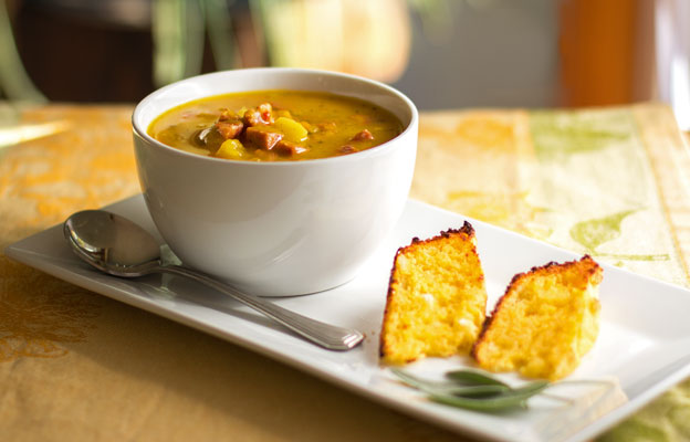 A robust pumpkin soup seasoned with sage and enhanced with apples and sausage for flavor and texture #soup #pumpkin mjskitchen.com
