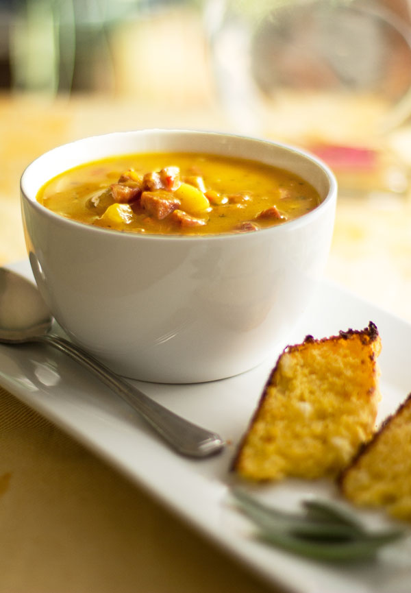 A robust pumpkin soup seasoned with sage and enhanced with apples and sausage for flavor and texture #soup #pumpkin #andouille #sage @mjskitchen