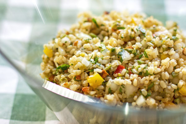 This brown rice salad is a healthy salad with brown rice, a mix of peppers (sweet & spicy), nuts and herbs, tossed with a Lime Dressing. mjskitchen.com