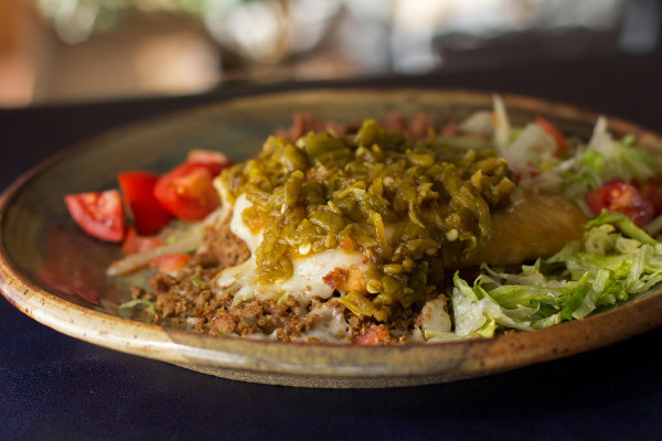 A sopapillas stuffed with beef, bean, rice and cheese, smothered in green chile sauce. @mjskitchen #sopapilla #greenchile
