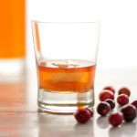 An Old Fashioned Cocktail enhanced with a dash of orange bitters and cranberries #cocktail #old-fashioned   mjskitchen.com