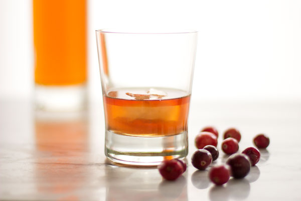 An Old Fashioned Cocktail enhanced with a dash of orange bitters and cranberries #cocktail #old-fashioned | mjskitchen.com