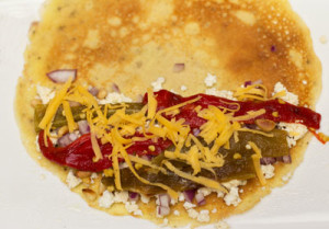 The assembly of green/red chile crepes