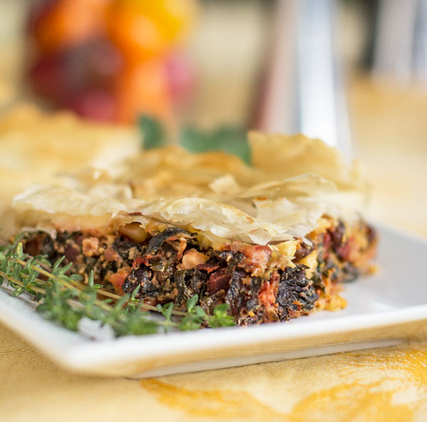 Swiss Chard Pie: A hearty vegetarian meal of Swiss chard, pine nuts, ricotto and feta wrapped in phyllo dough #phyllo #Swiss #chard #vegetarian mjskitchen.com