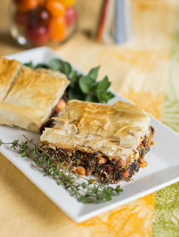 A hearty vegetarian meal of Swiss chard, pine nuts, ricotto and feta wrapped in phyllo dough #phyllo #Swiss #chard #vegetarian @mjskitchen
