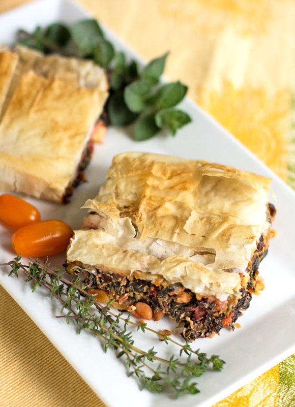 Swiss Chard Pie: A hearty vegetarian meal of Swiss chard, pine nuts, ricotto and feta wrapped in phyllo dough #phyllo #Swiss #chard #vegetarian @mjskitchen | mjskitchen.com
