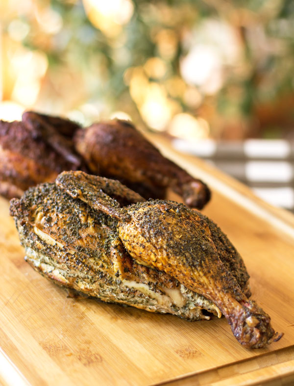 Smoked chicken with a spicy chile rub and a delectable herb rub #smoked #chicken @mjskitchen