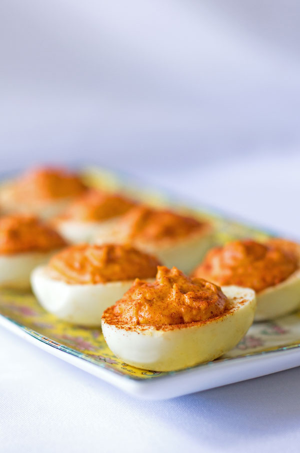 Gochujang Deviled Eggs - Spicy deviled eggs seasoned with gochujang, a Korean chili paste. #deviled #eggs #gouchujang @mjskitchen