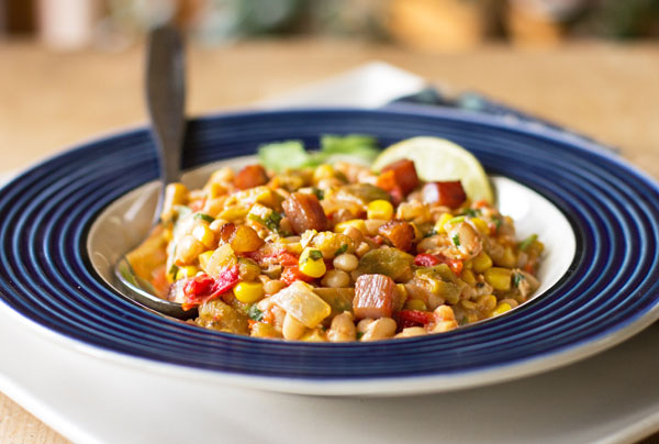 A hearty one pot meal with navy beans, green chile, corn, tomatoes and a host of other goodness. mjskitchen.com