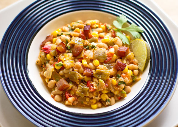 A hearty one pot meal with navy beans, green chile, corn, tomatoes and a host of other goodness. #green #chile #beans mjskitchen.com
